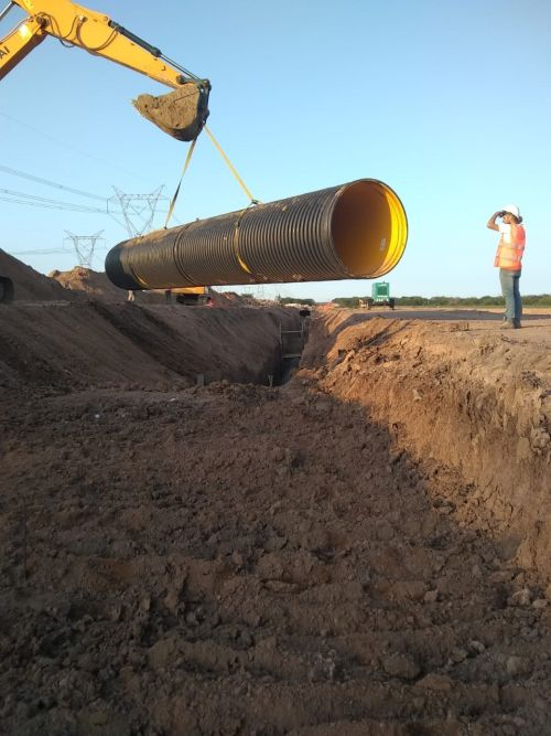 A Krah pipe is lowered into the ground
